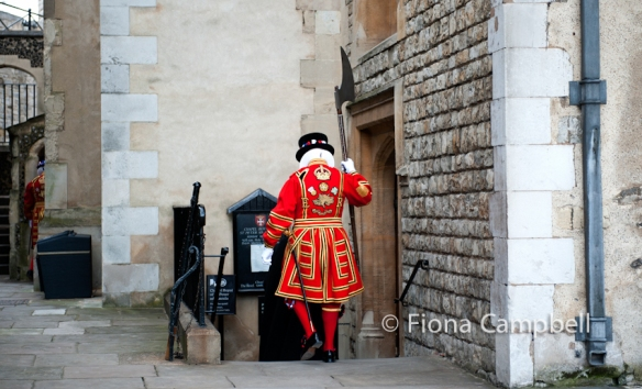 The Yeoman Gaoler carries the ceremonial axe into the Chapel.
