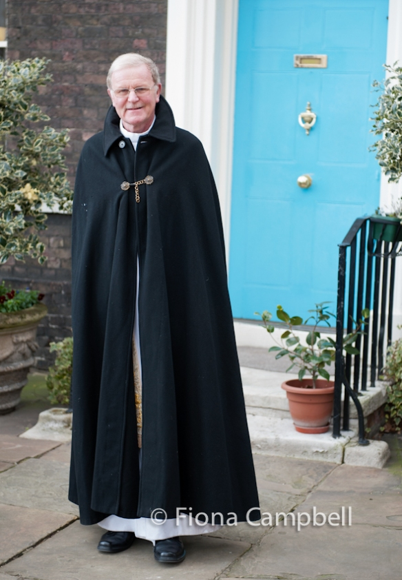 The Reverend, Roger J Hall MBE awaiting the arrival of the Parade before the Easter Sunday service.